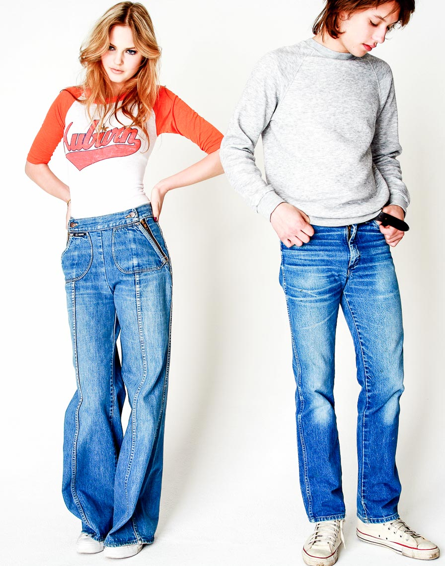 two teenagers being coy in a studio in ripped jeans
